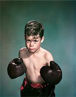 1940s - 1950s PORTRAIT BOY WEARING BOXING GLOVES AND TRUNKS Stock Photo - Premium Rights-Managednull, Code: 846-05647853