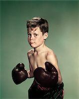 1940s - 1950s PORTRAIT BOY  WEARING BOXING GLOVES AND TRUNKS Stock Photo - Premium Rights-Managednull, Code: 846-05647855