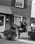 1950s MAN MAILMAN TRIPPING FALLING IN FRONT OF A SUBURBAN BRICK HOUSE ACCIDENT Stock Photo - Premium Rights-Managed, Artist: ClassicStock, Code: 846-05647905