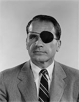 1960s PORTRAIT MIDDLE AGED MAN WEARING BLACK PATCH ON LEFT EYE SERIOUS FACIAL EXPRESSION Stock Photo - Premium Rights-Managednull, Code: 846-05647922
