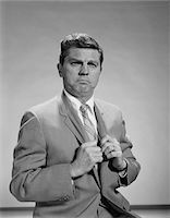 1960s PORTRAIT MIDDLE AGED MAN STERN SERIOUS EXPRESSION HANDS GRIPPING HIS LAPELS Stock Photo - Premium Rights-Managednull, Code: 846-05647942
