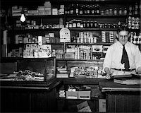 1930s GENERAL STORE INTERIOR GROCER OWNER BEHIND COUNTER Stock Photo - Premium Rights-Managednull, Code: 846-05647968