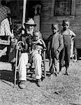 1939 ELDERLY AFRICAN AMERICAN MAN UNCLE AMBROSE DOUGLAS AGED 99 ONCE A SLAVE IS HOLDING THE YOUNGEST OF HIS 38 CHILDREN Stock Photo - Premium Rights-Managed, Artist: ClassicStock, Code: 846-05647970