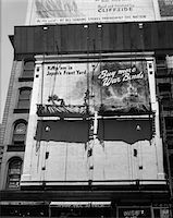 1940s - 1945 NEW YORK CITY SIGN PAINTERS CORNER 42nd STREET FIFTH AVENUE PAINTING NEW WAR BONDS SIGN FROM SCAFFOLD Stock Photo - Premium Rights-Managednull, Code: 846-05647994