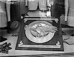 1940s - 1945 PLAQUE OF THE WAR VETERANS HONORABLE DISCHARGE BUTTON INSIGNIA IN STORE WINDOW Stock Photo - Premium Rights-Managed, Artist: ClassicStock, Code: 846-05647995