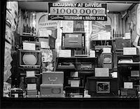 1940s WINDOW OF STORE SELLING RADIOS AND TELEVISIONS ADVERTISING A MILLION DOLLAR SALE Stock Photo - Premium Rights-Managednull, Code: 846-05648009