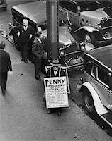 restaurant new york manhattan - 1930s NYC STREET DURING DEPRESSION WITH MAN WEARING SANDWICH BOARD ADVERTISING PENNY RESTAURANT Stock Photo - Premium Rights-Managednull, Code: 846-05648034