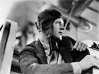 1920s CLOSE-UP OF CHARLES LINDBERG IN LEATHER AVIATOR CAP SITTING IN COCKPIT OF PLANE Stock Photo - Premium Rights-Managednull, Code: 846-05648037