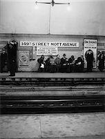 1930s MEN AND WOMEN WAITING FOR SUBWAY TRAIN 149th STREET MOTT AVENUE BRONX NEW YORK CITY Stock Photo - Premium Rights-Managednull, Code: 846-05648040