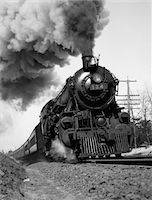 steam engine - 1920s - 1930s STEAM ENGINE PULLING PASSENGER TRAIN SMOKE BILLOWING FROM EXHAUST STACK Stock Photo - Premium Rights-Managednull, Code: 846-05648050