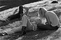 1960s - 1970s HIPPIE COUPLE WOMAN WITH LONG BLONDE HAIR SIT BESIDE MAN LYING IN GRASS Stock Photo - Premium Rights-Managednull, Code: 846-05648065
