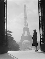 1920s - 1930s MOODY SILHOUETTED WOMAN PARIS STANDING IN TROCADERO LOOKING TOWARD EIFFEL TOWER Stock Photo - Premium Rights-Managednull, Code: 846-05648071