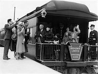 platform - 1930s FAMILY WITH GRANDPARENTS & CONDUCTOR ON BROADWAY LIMITED OBSERVATION CAR TRAIN PLATFORM WAVING GOODBYE & FAREWELL Stock Photo - Premium Rights-Managednull, Code: 846-05648088
