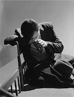 people sitting on bench - 1960s BUSINESSMAN SITTING ON BENCH HEAD DOWN ON ARMS SLUMPED OVER SAD DEPRESSED Stock Photo - Premium Rights-Managednull, Code: 846-05648147