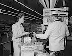 1960s WOMAN PAYING AT GROCERY STORE CHECKOUT MALE CASHIER Stock Photo - Premium Rights-Managed, Artist: ClassicStock, Code: 846-05648151