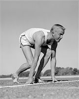 1960s MAN SPRINTER RUNNER AT THE STARTING LINE FOR FOOT RACE OUTDOOR Stock Photo - Premium Rights-Managednull, Code: 846-05648173