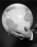 1960s MANS HAND HOLDING GLOBE OF THE WORLD Stock Photo - Premium Rights-Managednull, Code: 846-05648191