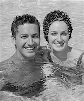 1960s SMILING COUPLE MAN WOMAN IN SWIMMING POOL Stock Photo - Premium Rights-Managednull, Code: 846-05648201