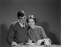 story - 1960s COUPLE COUNTING COINS FROM PIGGY BANK Stock Photo - Premium Rights-Managednull, Code: 846-05648239