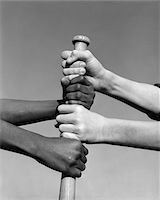 1960s AFRICAN-AMERICAN AND CAUCASIAN HANDS GRIPPING BASEBALL BAT Stock Photo - Premium Rights-Managednull, Code: 846-05648265