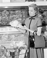 1950s - 1960s BLOND WOMAN SELECTING POULTRY IN SUPERMARKET Stock Photo - Premium Rights-Managednull, Code: 846-05648298