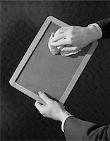 slate - 1930s MAN HANDS HOLDING RAG WIPING SLATE CHALKBOARD CLEAN Stock Photo - Premium Rights-Managednull, Code: 846-05648316