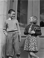 1940s SMILING BOY & GIRL HOLDING SCHOOL BOOKS BY DOORS Stock Photo - Premium Rights-Managednull, Code: 846-05648351