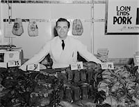 1930s - 1940s PORTRAIT SMILING MAN BUTCHER GROCER AT MEAT COUNTER Stock Photo - Premium Rights-Managednull, Code: 846-05648368