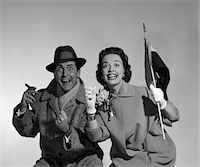 1950s COUPLE PORTRAIT IN COATS ROOTING FOR HOME TEAM Stock Photo - Premium Rights-Managednull, Code: 846-05648385