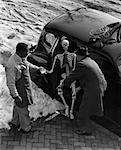 1930s TWO MEN TAKING SKELETON OUT OF BACK SEAT OF CAR OUTDOOR WINTER Stock Photo - Premium Rights-Managed, Artist: ClassicStock, Code: 846-05648405