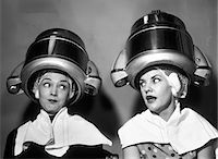 retro beauty salon images - 1950s TWO WOMEN SITTING TOGETHER GOSSIPING UNDER HAIRDRESSER HAIR DRYER Stock Photo - Premium Rights-Managednull, Code: 846-05648409