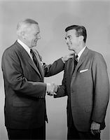 1950s OLDER AND YOUNGER BUSINESS MEN SHAKING HANDS Stock Photo - Premium Rights-Managednull, Code: 846-05648428