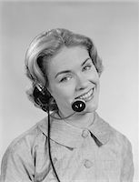 1960s SMILING WOMAN TELEPHONE OPERATOR WEARING HEADSET Stock Photo - Premium Rights-Managednull, Code: 846-05648434