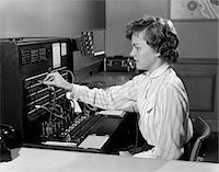 switchboard operator - 1950s WOMAN OFFICE TELEPHONE SWITCHBOARD RECEPTIONIST OPERATOR WEARING HEADSET ANSWERING TRANSFERRING CALL Stock Photo - Premium Rights-Managednull, Code: 846-05648441
