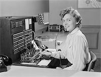 switchboard operator - 1950s SMILING WOMAN OFFICE TELEPHONE SWITCHBOARD OPERATOR Stock Photo - Premium Rights-Managednull, Code: 846-05648442