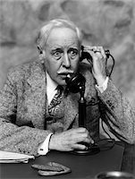 1920s - 1930s BUSINESSMAN ON CANDLESTICK TELEPHONE LOOKING SURPRISED AND ALARMED Stock Photo - Premium Rights-Managednull, Code: 846-05648453