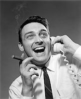 1950s - 1960s EXCITED MAN TALKING ON TELEPHONE GRINNING SMOKING CIGAR INDOOR Stock Photo - Premium Rights-Managednull, Code: 846-05648462