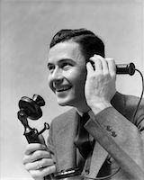 1920s - 1930s MAN TALKING ON CANDLESTICK PHONE Stock Photo - Premium Rights-Managednull, Code: 846-05648476