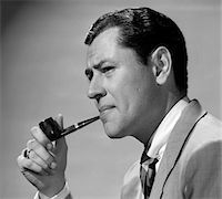1950s FROWNING BUSINESSMAN IN JACKET AND TIE SMOKING A PIPE Stock Photo - Premium Rights-Managednull, Code: 846-05648499