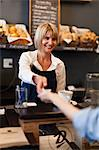 Smiling woman working in cafe Stock Photo - Premium Royalty-Free, Artist: AWL Images, Code: 649-05648983