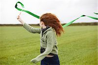 streamer - Teenage girl playing with ribbon Stock Photo - Premium Royalty-Freenull, Code: 649-05649187
