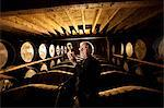 Worker testing whisky in distillery Stock Photo - Premium Royalty-Freenull, Code: 649-05649262