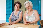 Older women making pasta together Stock Photo - Premium Royalty-Free, Artist: Blend Images, Code: 649-05649280