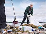 Environmentalist cleaning up beach Stock Photo - Premium Royalty-Free, Artist: oliv, Code: 649-05649427