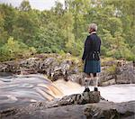 Time lapse view of man in kilt by river Stock Photo - Premium Royalty-Free, Artist: CulturaRM, Code: 649-05649433