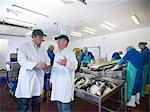 Workers talking in fish processing plant Stock Photo - Premium Royalty-Freenull, Code: 649-05649447