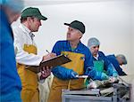 Workers talking in fish processing plant Stock Photo - Premium Royalty-Freenull, Code: 649-05649450