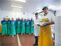 Workers in fish processing plant Stock Photo - Premium Royalty-Freenull, Code: 649-05649455