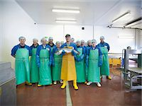Workers in fish processing plant Stock Photo - Premium Royalty-Freenull, Code: 649-05649457