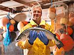 Fisherman holding salmon on boat Stock Photo - Premium Royalty-Free, Artist: Robert Harding Images, Code: 649-05649524